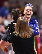 Abby Weber celebrates with her coaches following her vault during 2019 Minnesota gymnastics Class A team competition Friday, Feb. 22, at Maturi Pavilion in Minneapolis.