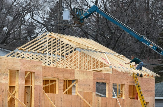 Trusses are placed for the roof of the new Dutch Maid Bakery location Friday, April 5, on Benton Drive North between Fifth and Sixth Streets in Sauk Rapids.