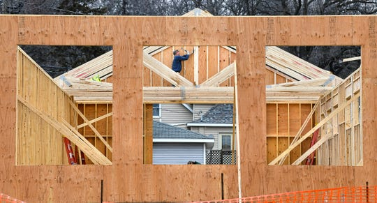 Roof trusses are put into place at the new Dutch Maid Bakery location Friday, April 5, on Benton Drive North between Fifth and Sixth Streets in Sauk Rapids.