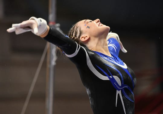 Abby Weber completes her uneven bars performance during 2019 Minnesota gymnastics Class A team competition Friday, Feb. 22, at Maturi Pavilion in Minneapolis.