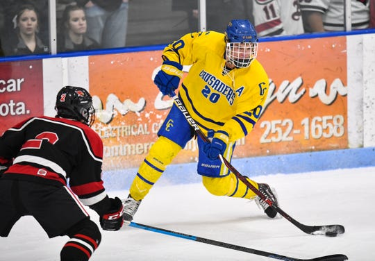 Cathedral's Jack Smith passes the puck during the first period of the Section 6A championship game Thursday, Feb. 28, at the MAC in St. Cloud.