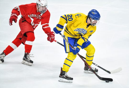 Cathedral's Jack Smith gets past Matt Courtright of North Branch during the Minnesota Boys Hockey Tournament Class A quarterfinals Wednesday, March 6, at the Xcel Energy Center in St. Paul.