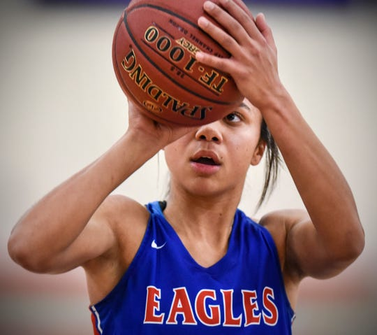 Lariah Washington concentrates on a free throw during the Thursday, Jan. 17, game at Apollo High School in St. Cloud.