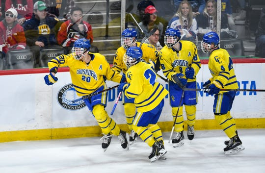 Cathedral players celebrate a goal by Jack Smith in the second period during the 2019 state tournament championship semifinals game Friday, March 8, at the Xcel Energy Center in St. Paul.