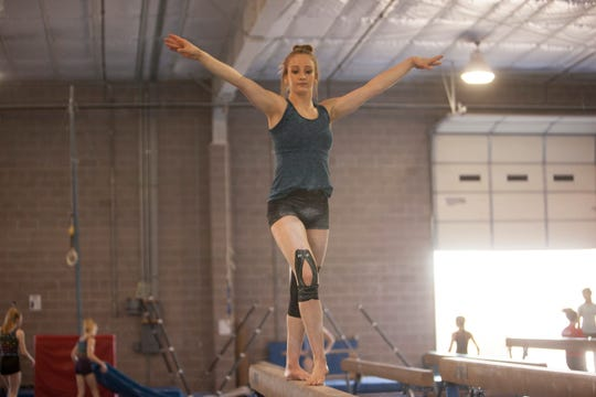 Bare Foot Gymnastics' Jocelyn Wittwer practices on the balance beam.
