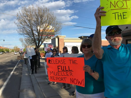 St. George protesters gathered outside U.S. Rep. Chris Stewart's office demanding a full release of the report prepared by Special Counsel Robert Mueller into Russian influence on the 2016 election.