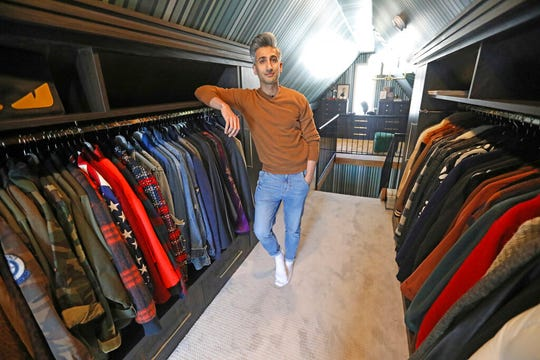 "In this March 15, 2019, photo, Tan France, a cast member on the Netflix series ""Queer Eye,"" poses among his clothes in the attic of his home in Salt Lake City. The series touches on some of the country's deepest divides with persistent optimism. The makeover program starring five gay men tackles the contrast between urban and rural, white and black, liberal and conservative.  (AP Photo/Rick Bowmer)"