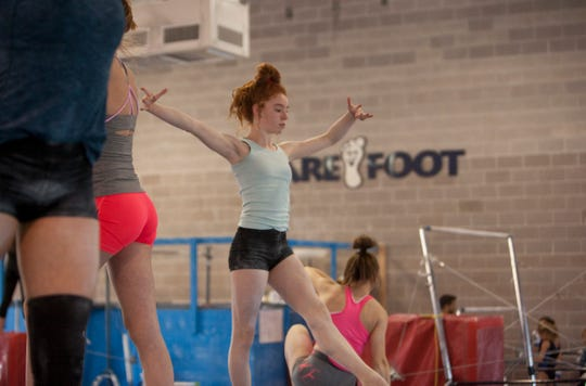 Barefoot Gymnastics' Ireland McGiven practices during a session in 2019.