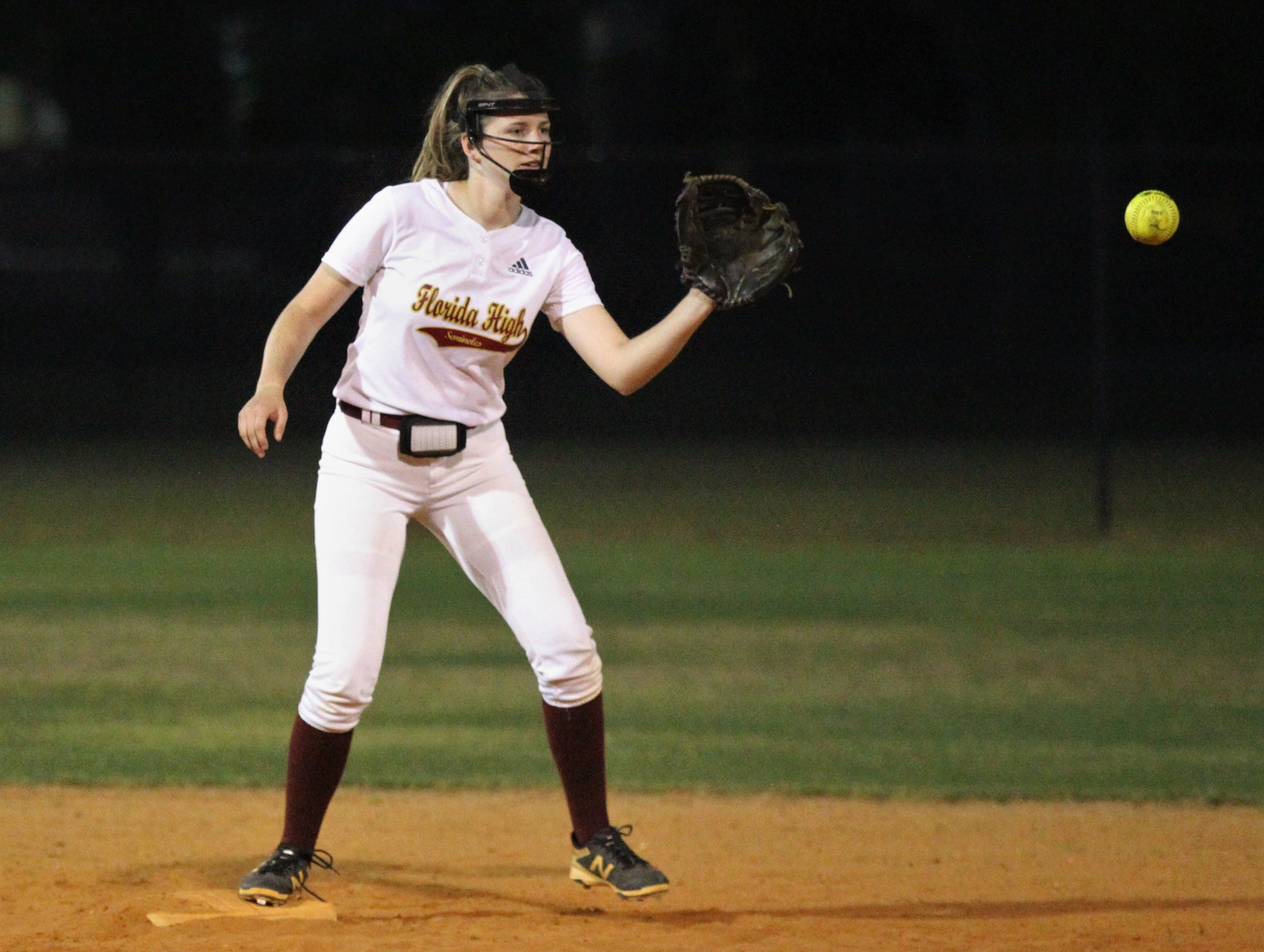 Florida High shortstop Addisan Langston waits on a throw for a force out as Lincoln's softball team beat Florida High 7-3 on Thursday, April 4, 2019.
