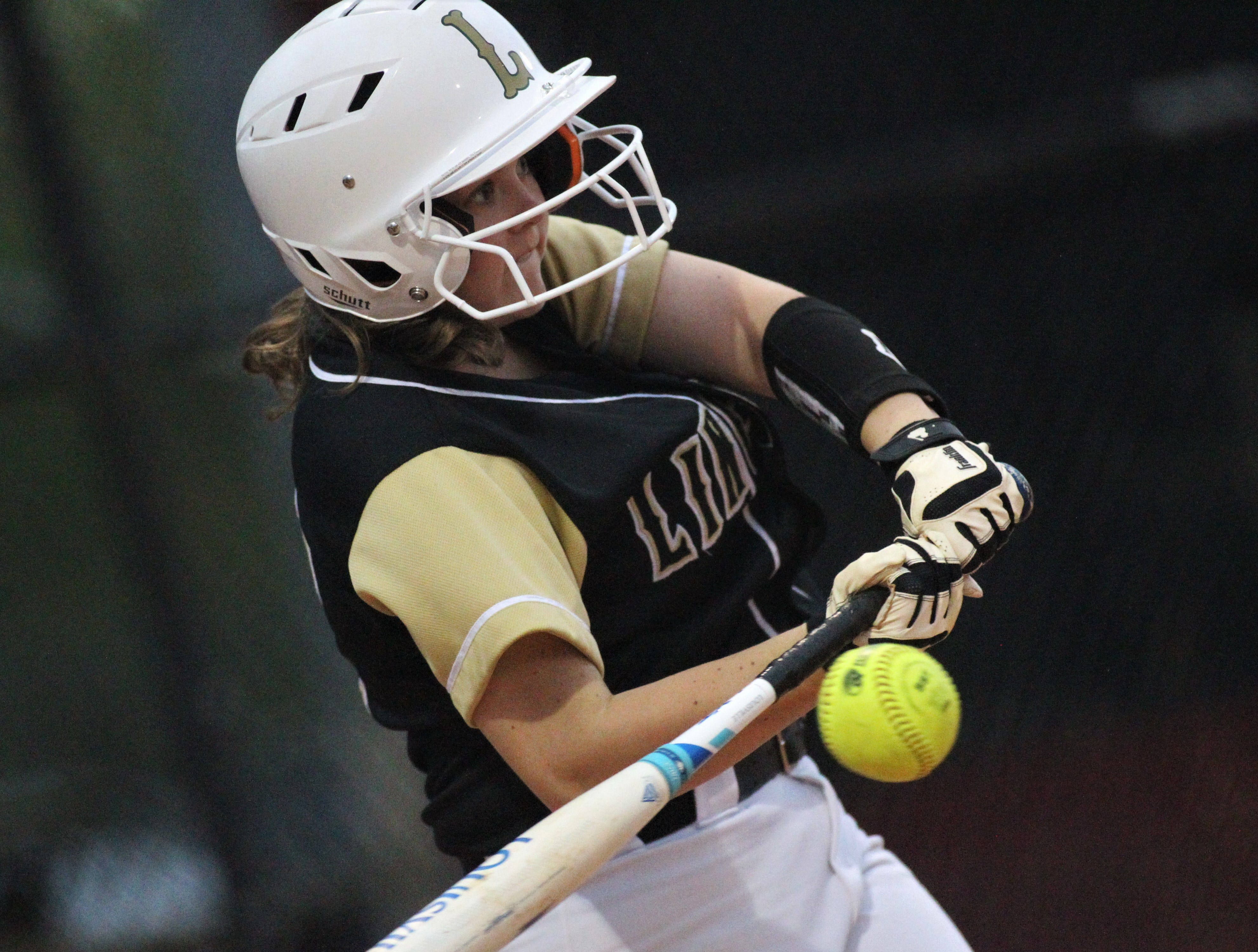 Lincoln sophomore Tayler Barrett bats as Lincoln's softball team beat Florida High 7-3 on Thursday, April 4, 2019.