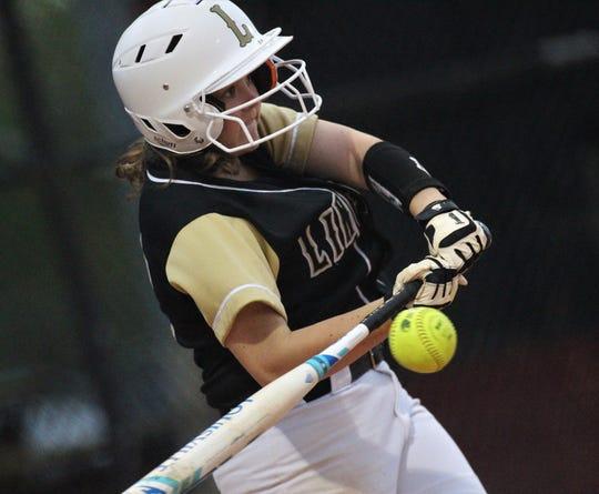 Lincoln sophomore Tayler Barrett bats as Lincoln's softball team beat Florida High 7-3 on Thursday, April 4, 2019.