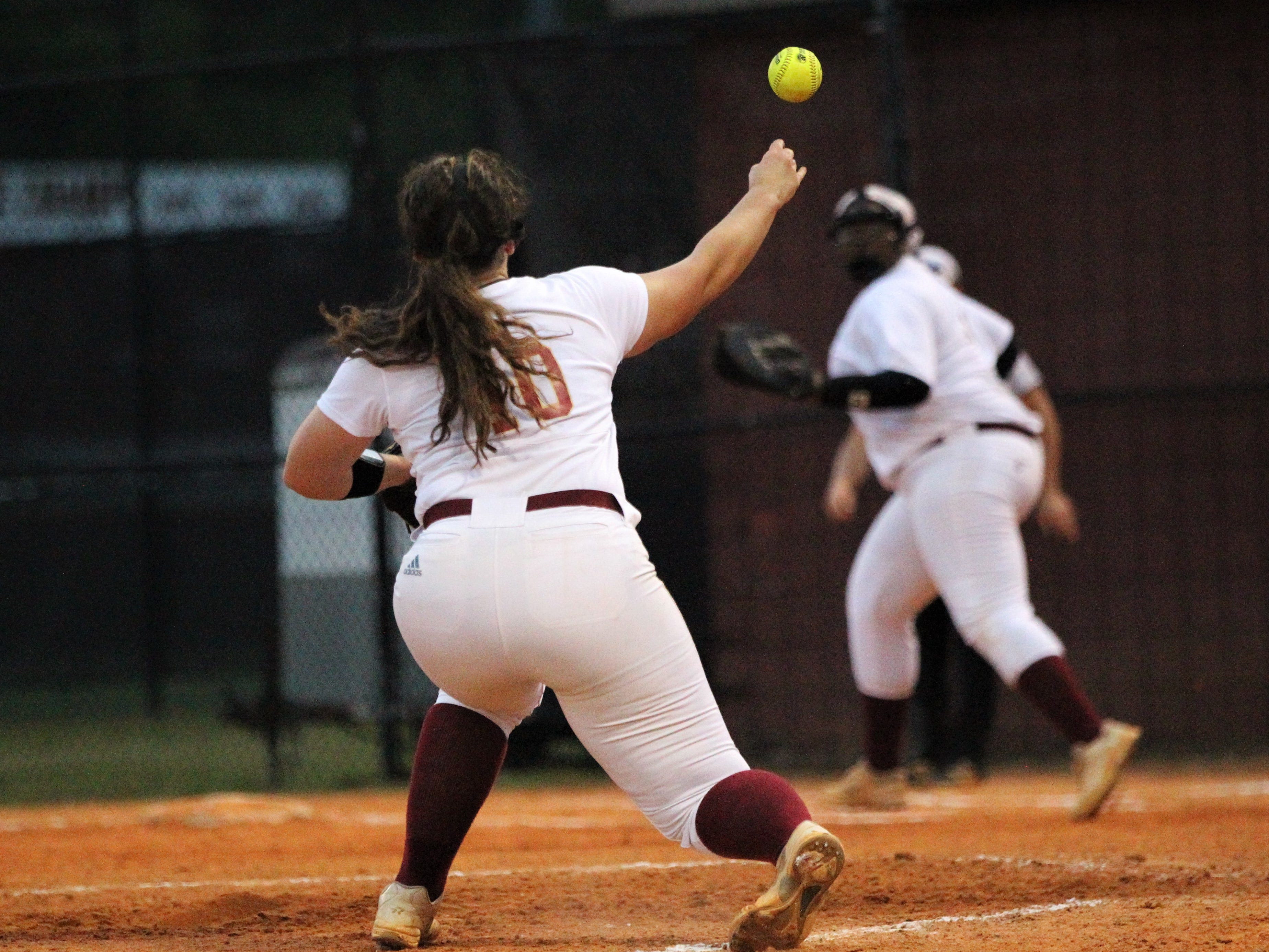Florida High pitcher Julia Hayes throws to first to try to record an out as Lincoln's softball team beat Florida High 7-3 on Thursday, April 4, 2019.