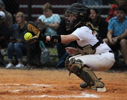 Florida High freshman Camryn Miller catches a pitch as Lincoln's softball team beat Florida High 7-3 on Thursday, April 4, 2019.