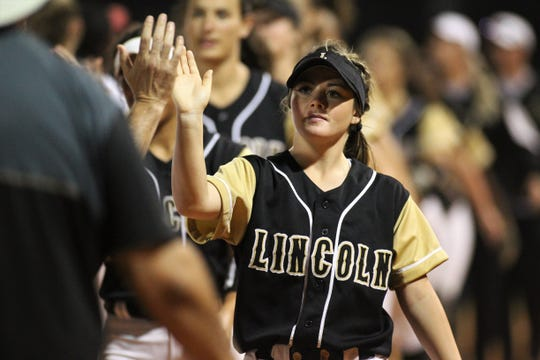 Lincoln senior Shelby Sloan leads a postgame handshake line after Lincoln's softball team beat Florida High 7-3 on Thursday, April 4, 2019.