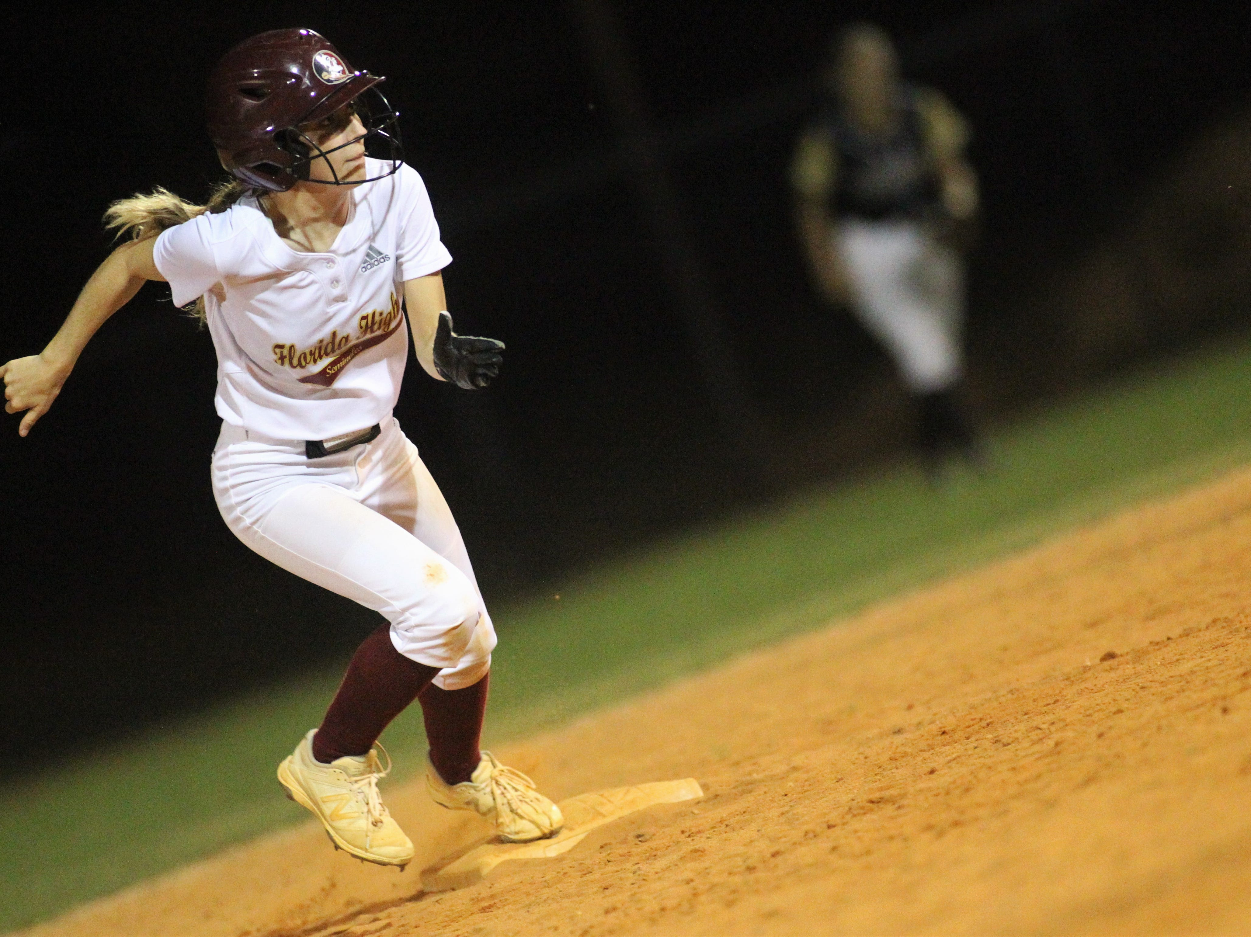 Florida High junior Grace McDaniel takes off from second base as Lincoln's softball team beat Florida High 7-3 on Thursday, April 4, 2019.