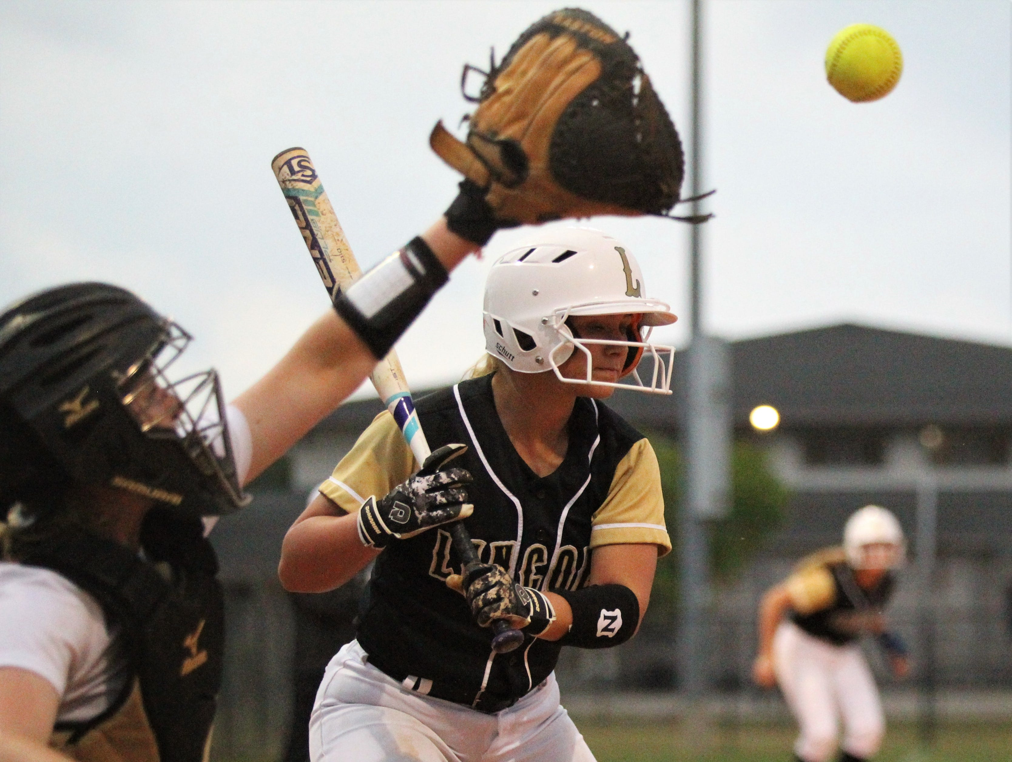 Lincoln junior Emma Alley watches a high pitch as Lincoln's softball team beat Florida High 7-3 on Thursday, April 4, 2019.