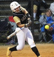 Lincoln junior Emma Alley swings at a pitch as Lincoln's softball team beat Florida High 7-3 on Thursday, April 4, 2019.