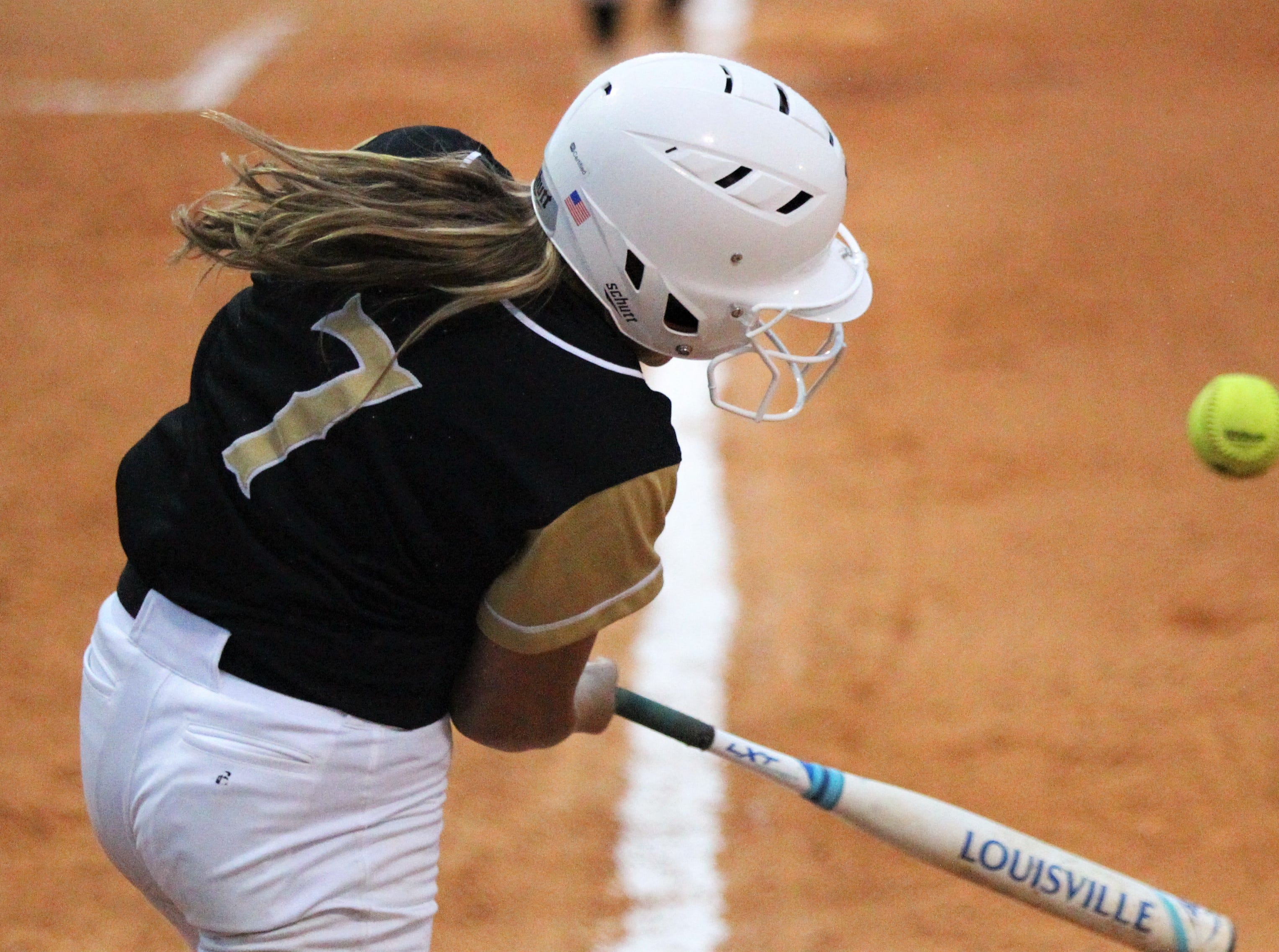 Lincoln freshman Gwendolen McGinnis belts a hit as Lincoln's softball team beat Florida High 7-3 on Thursday, April 4, 2019.