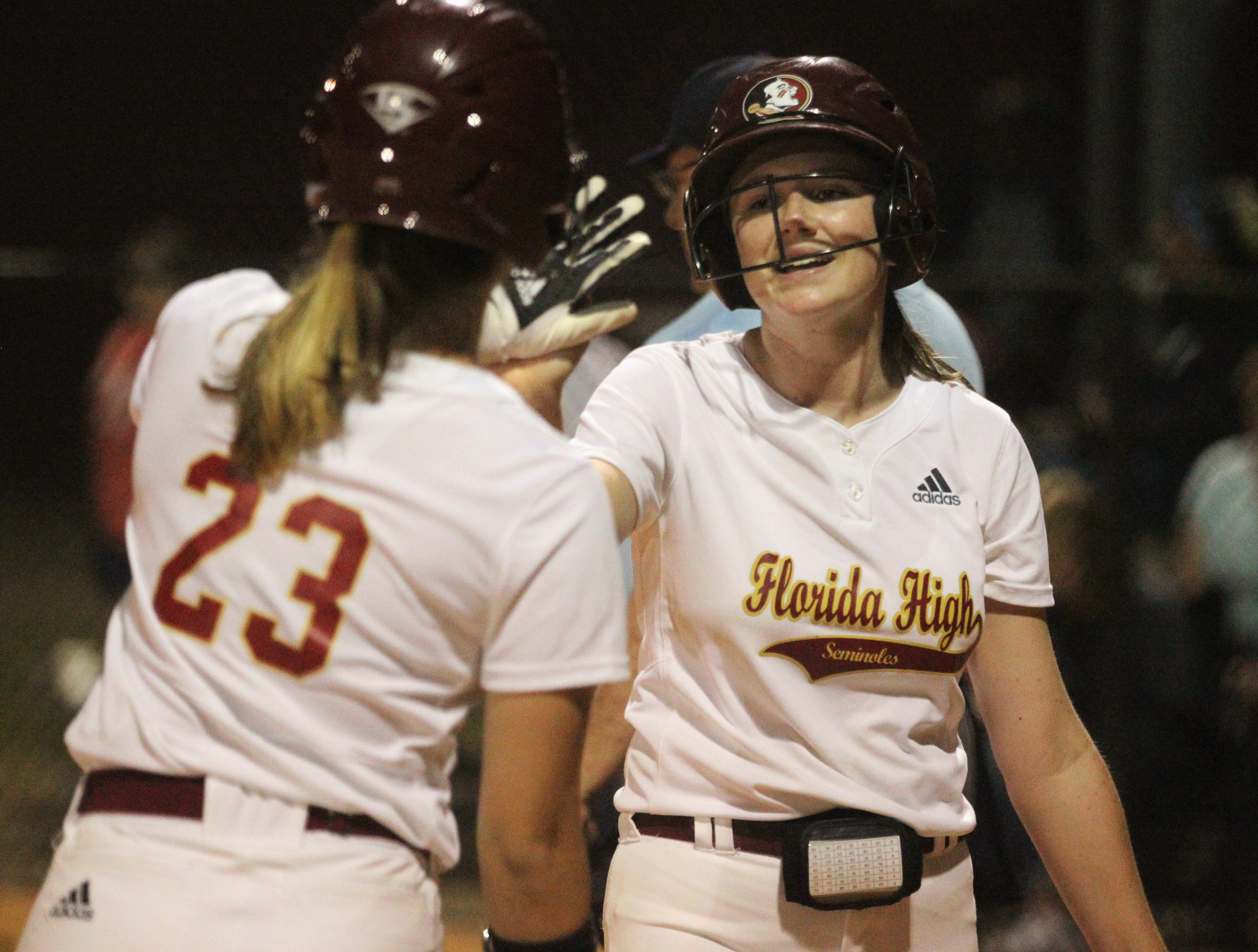 Florida High sophomore Addisan Langston is congratulated after scoring a run as Lincoln's softball team beat Florida High 7-3 on Thursday, April 4, 2019.