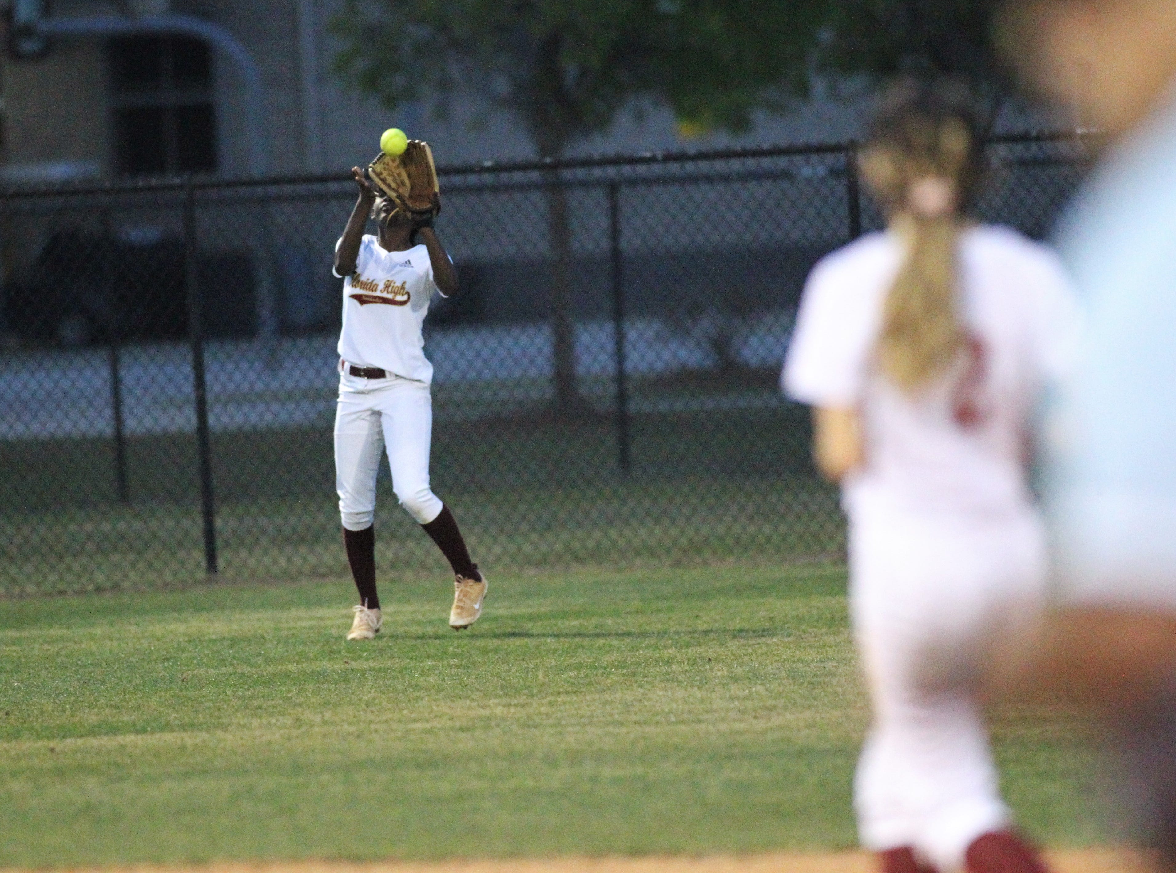 Florida High freshman outfielder Jordyn still catches a fly ball as Lincoln's softball team beat Florida High 7-3 on Thursday, April 4, 2019.