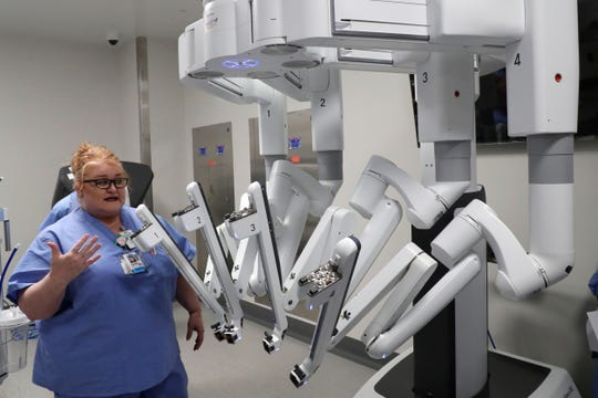 Laura Blakney, nurse manager of operations, shows off the Da Vinci surgery system in an operating room in the M.T. Mustian Center at Tallahassee Memorial Hospital Friday, April 5, 2019.