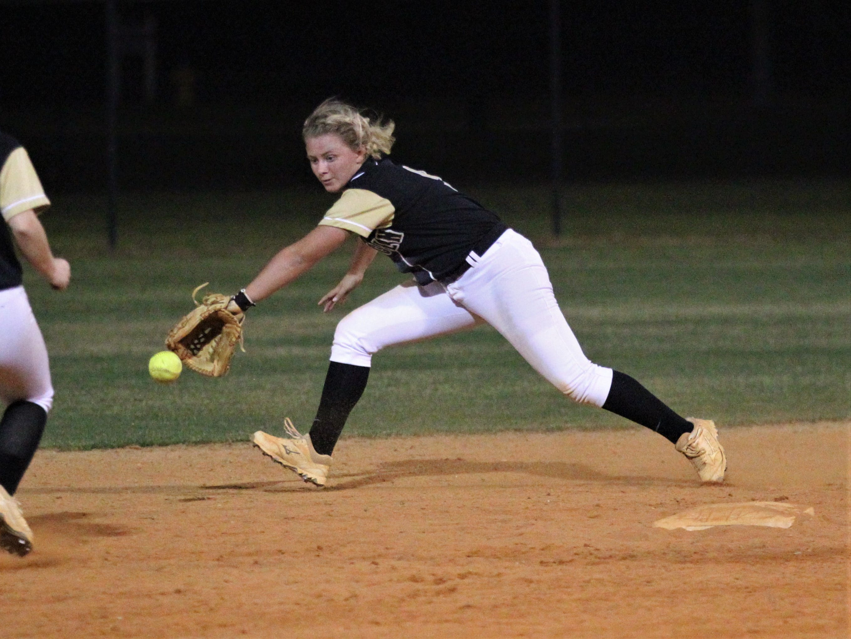 Lincoln second baseman tries to reach a ground ball up the middle as Lincoln's softball team beat Florida High 7-3 on Thursday, April 4, 2019.