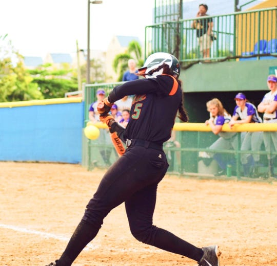 FAMU's Alexis Day shortens her swing for an inside pitch during a recent road game.
