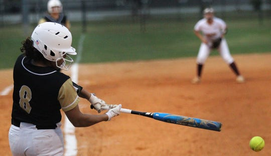 Lincoln sophomore Angelique Mann-Penn laces a hit as Lincoln's softball team beat Florida High 7-3 on Thursday, April 4, 2019.