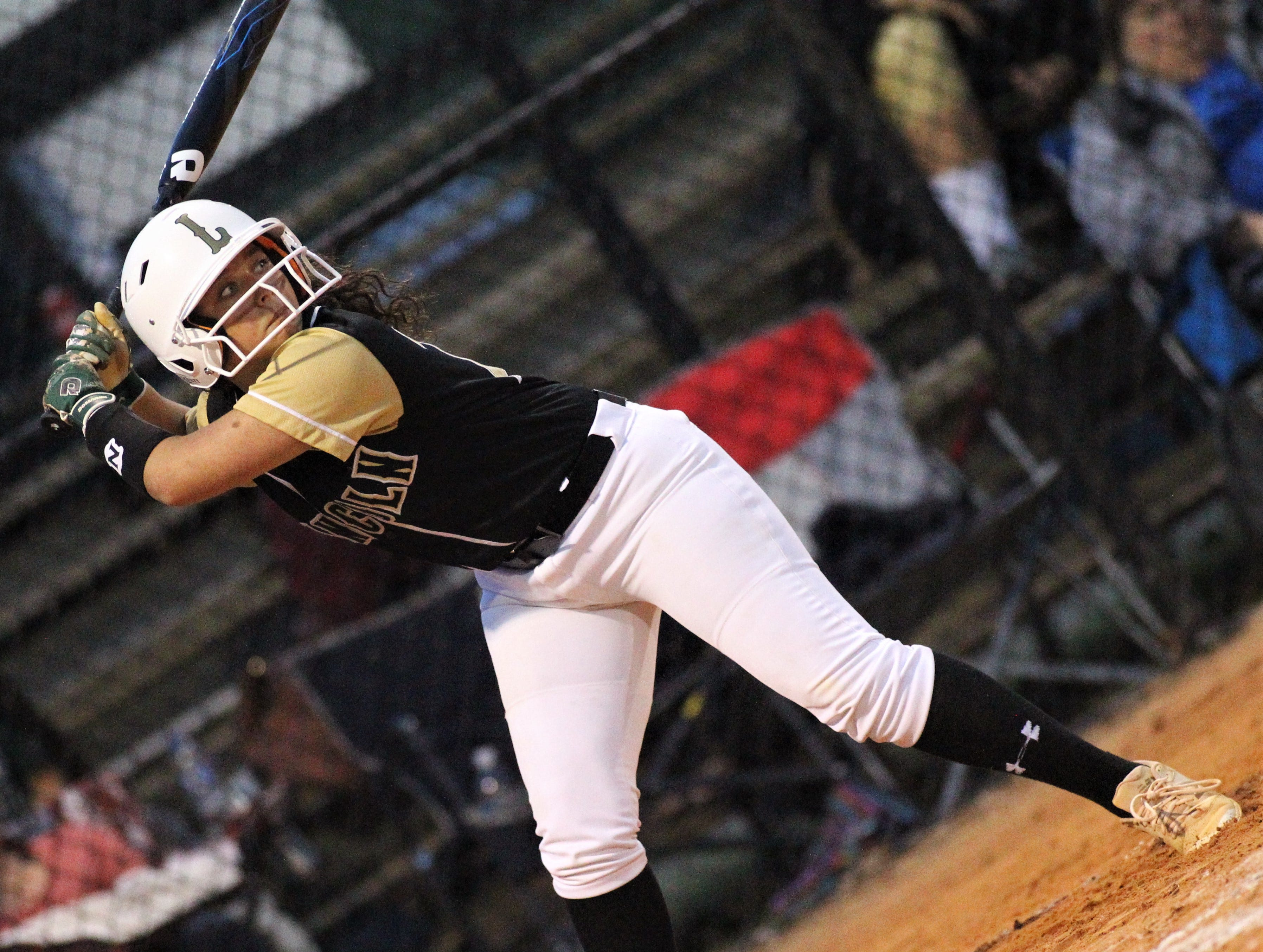 Lincoln sophomore Aydan Milgrom bats as Lincoln's softball team beat Florida High 7-3 on Thursday, April 4, 2019.