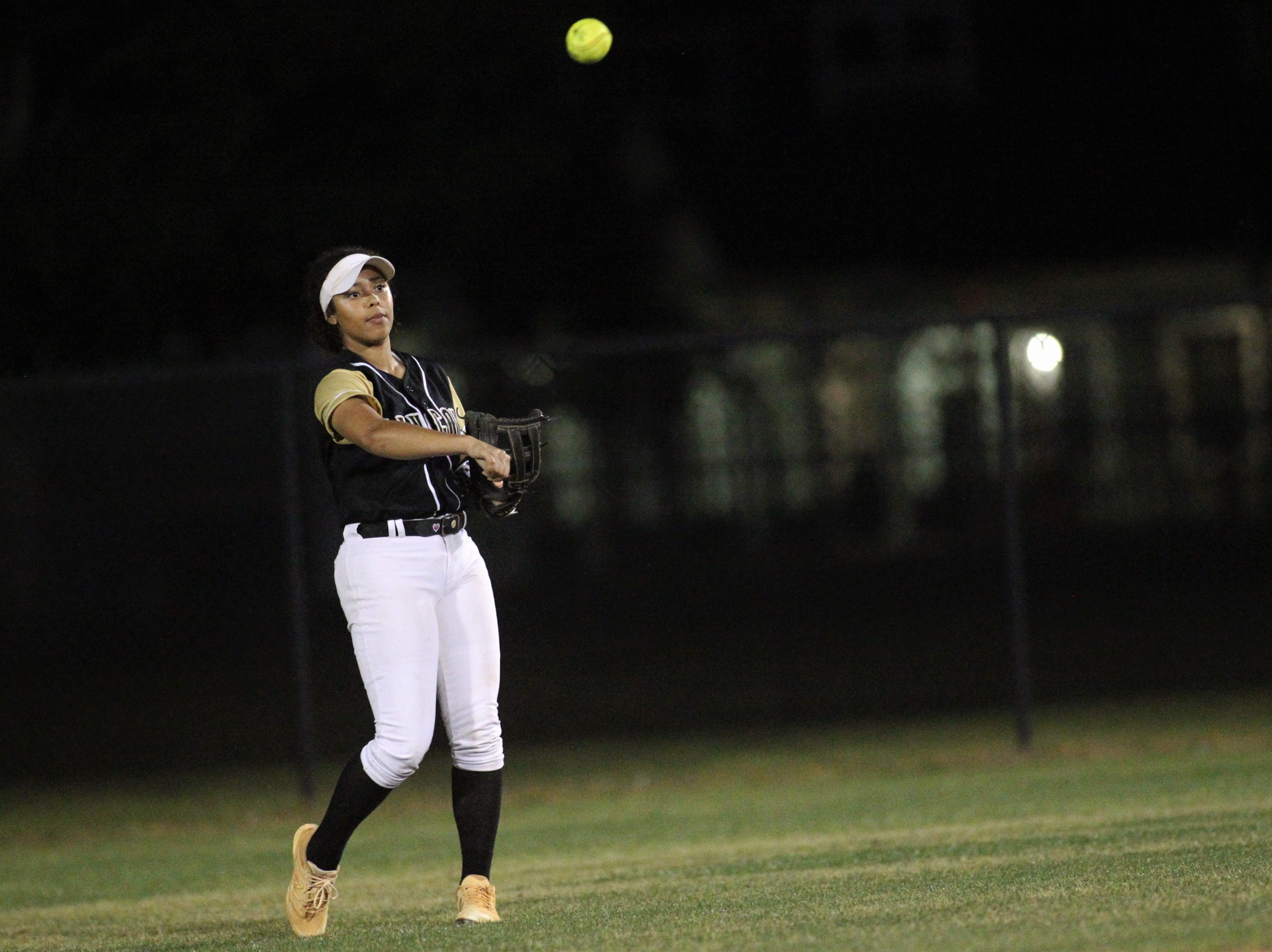 Lincoln sophomore Angelique Mann-Penn throws a ball back in from the outfield as Lincoln's softball team beat Florida High 7-3 on Thursday, April 4, 2019.