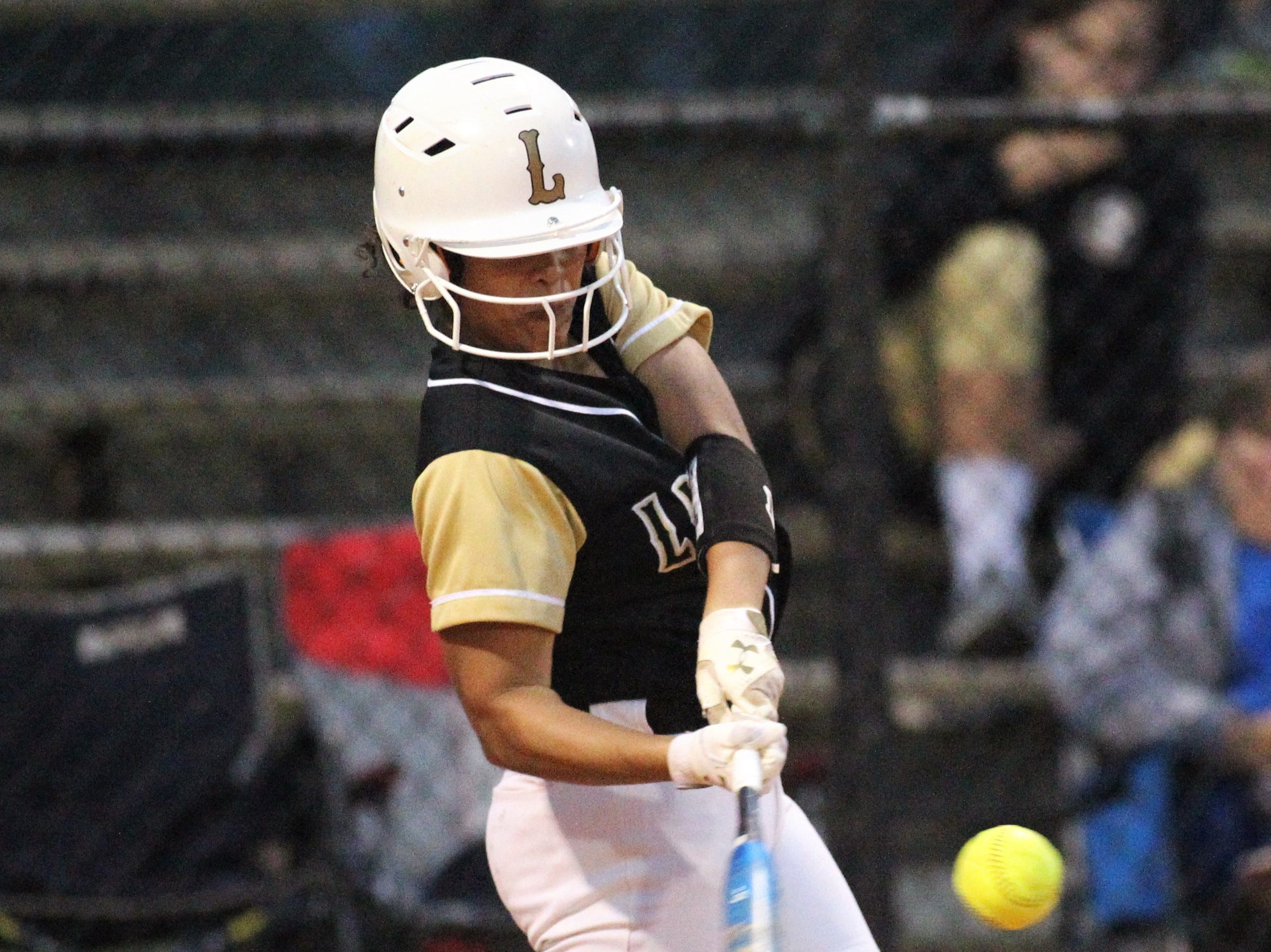 Lincoln junior Emily Zettle bats as Lincoln's softball team beat Florida High 7-3 on Thursday, April 4, 2019.
