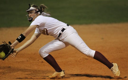Florida High freshman third baseman Rileigh Spinosa snags a hard-hit ground ball as Lincoln's softball team beat Florida High 7-3 on Thursday, April 4, 2019.