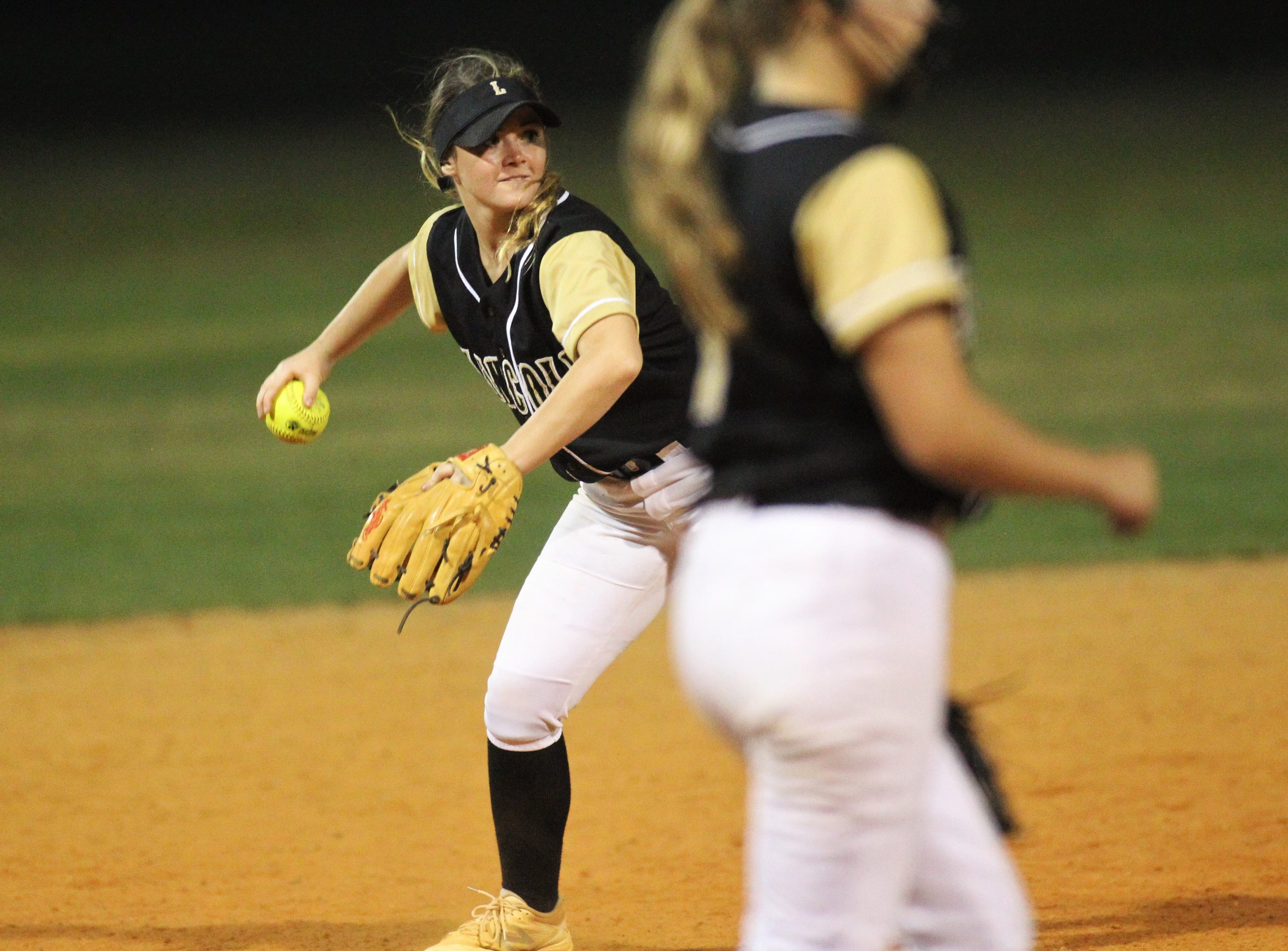 Lincoln senior shortstop Shelby Sloan throws to first for an out as Lincoln's softball team beat Florida High 7-3 on Thursday, April 4, 2019.