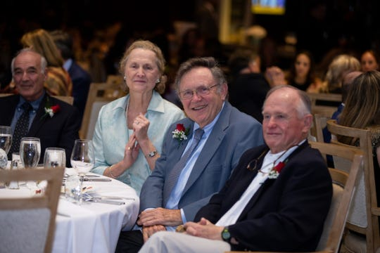 Margaret Lawler, left, with Dr. Peter Lawler and Dr. Bruce Wiita at Jupiter Medical Center's 40th anniversary celebration at Frenchman's Reserve in Palm Beach Gardens.