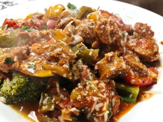 Lorenzo serves sweet Italian sausage sauteed with colorful peppers and crowned with Lorenzo's tomato sauce.