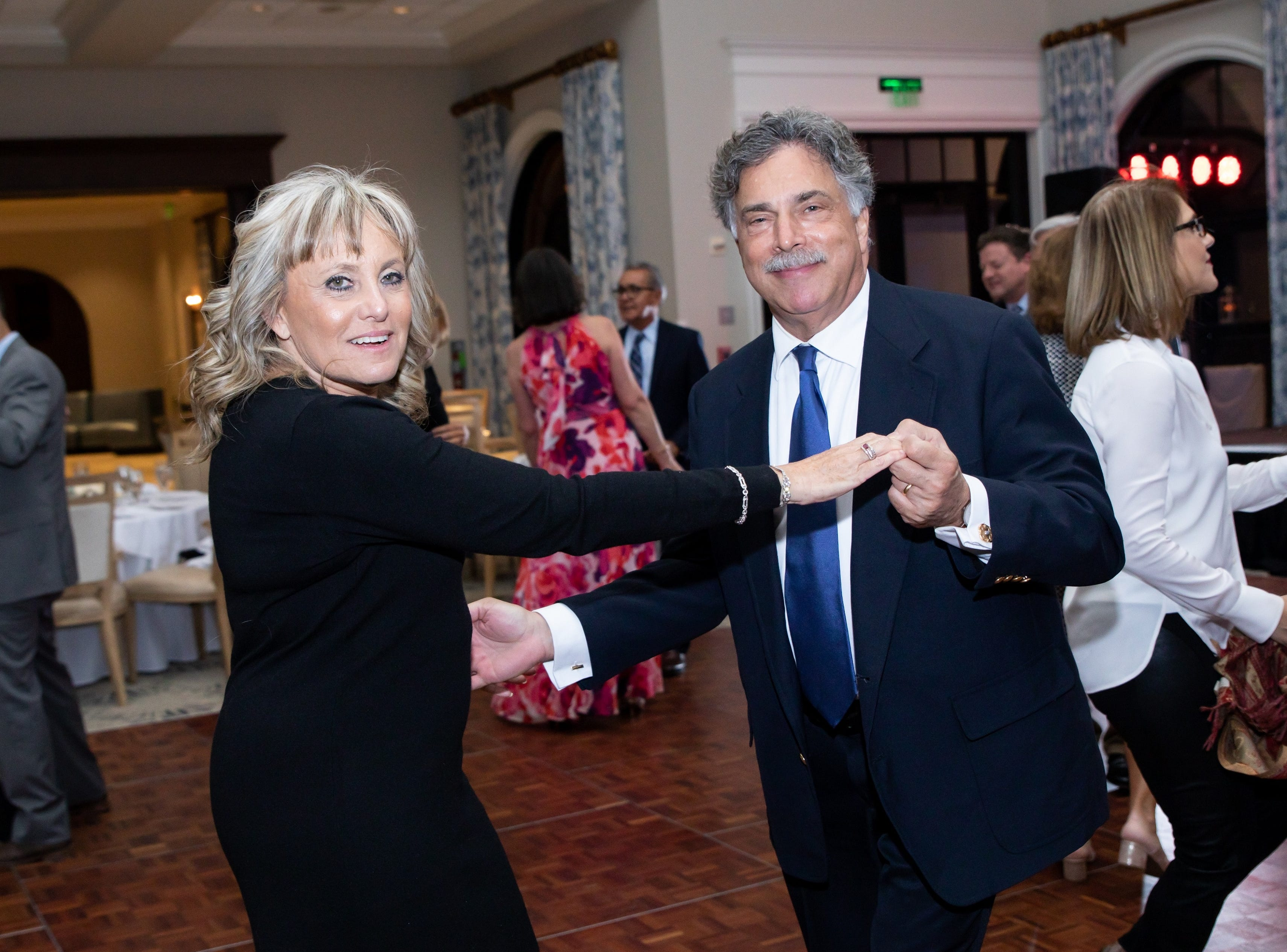Lori and Dr. Michael Jacobs share a dance at the Jupiter Medical Center's 40th anniversary celebration at Frenchman's Reserve in Palm Beach Gardens.