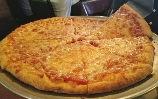 Mario's Napoleton pizza had a crispy crust, rustic sauce, and a generous amount of mozzarella cheese.