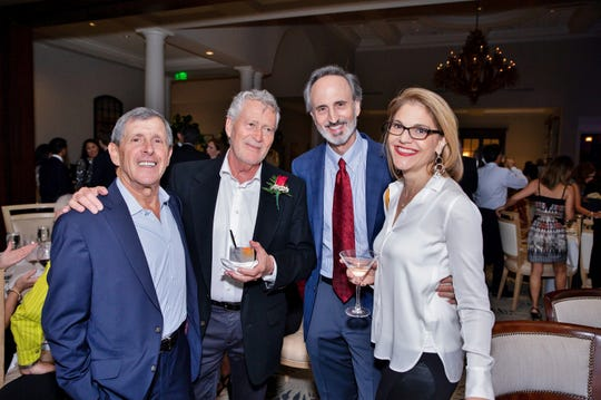 Dr. Sheldon Taub, left, with Dr. John Katona, Dr. Nathaniel Drourr and Dr. Cathy Drourr at Jupiter Medical Center's 40th anniversary celebration at Frenchman's Reserve in Palm Beach Gardens.