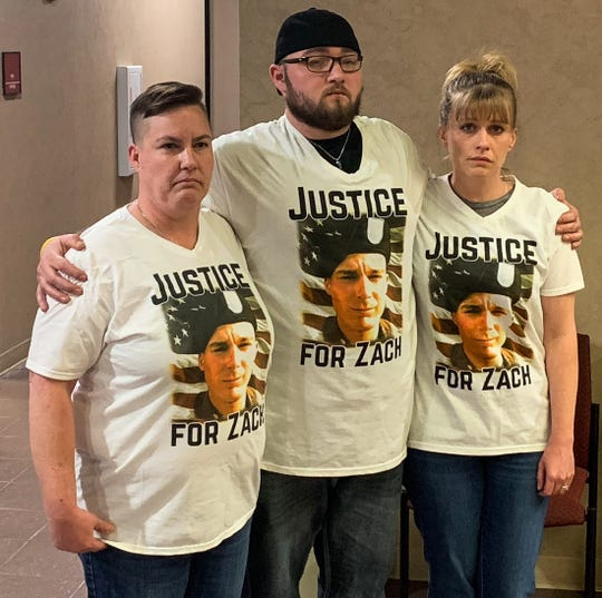Pfc. Zachary S. McGuire's mother, Amber Wright, left, stands beside his brother and aunt on Friday, April 5, 2019, after the sentence was read in his slaying.