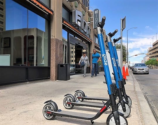 Glide electric scooters are parked outside the Aloft Hotel in Downtown El Paso. The El Paso company is the first to get a permit to rent scooters in the city's scooter pilot program.