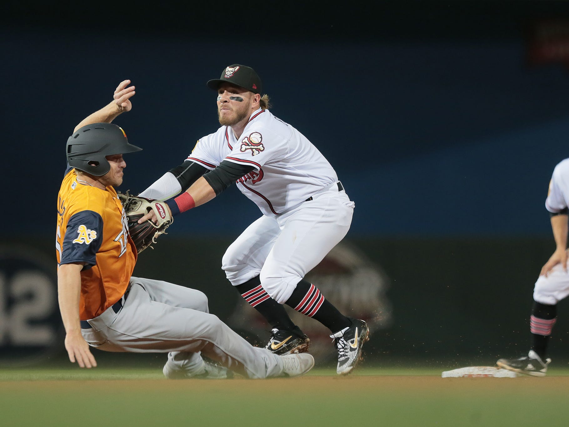 El Paso second baseman Esteban Quiroz appears to tag Las Vegas baserunner Corban Joseph on the approach to second base on opening night for the Chihuahuas. Joseph was called safe on the play.