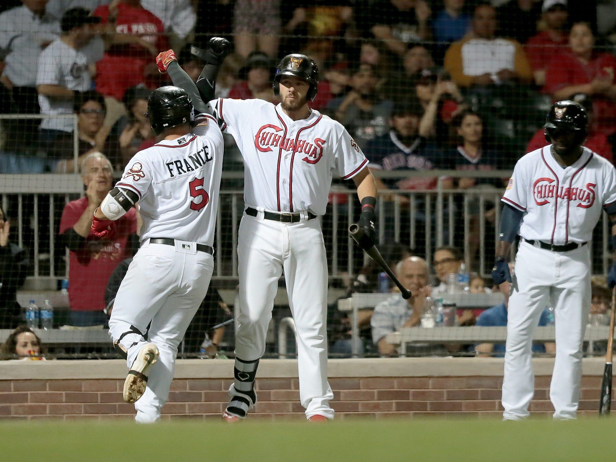Ty France celebrates his homerun with catcher Austin Allen Thursday at Southwest University Park.