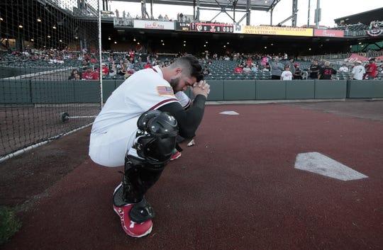 Chihuahuas' catcher Austin Allen has a prayer on opening night against Las Vegas Thursday night.