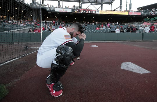 Chihuahuas' catcher Austin Allen prays on opening night against Las Vegas.
