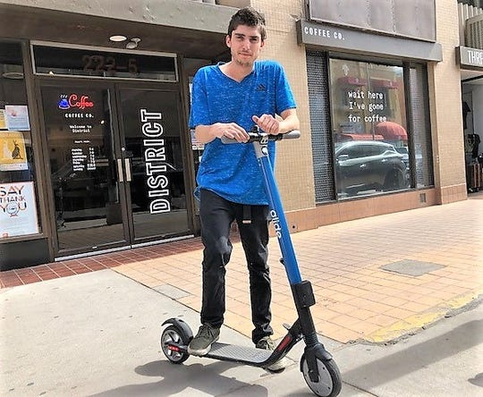 El Pasoan Gavin Pimenta, 21, prepares to ride a Glide electric scooter April 5 in Downtown El Paso.