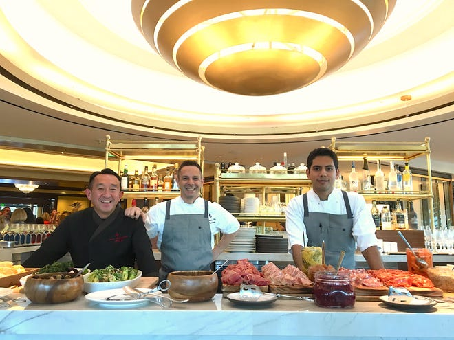 Celebrating the grand opening of Coin & Candor at Four Seasons Hotel Westlake Village are, from left, chef Masa Shimakawa of ONYX, executive chef Jose Fernandez and chef de cuisine Jesus Medina.