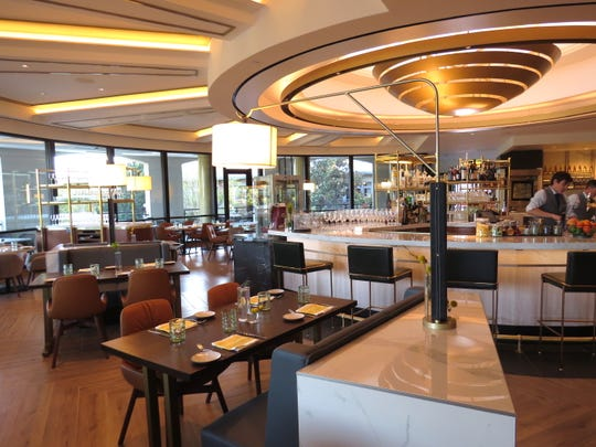 Midcentury-inspired furnishings and an in-the-round bar are part of the decor at Coin & Candor, a new restaurant at Four Seasons Hotel Westlake Village.