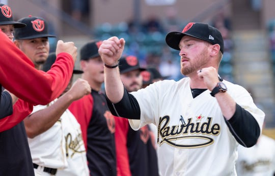 Visalia Rawhide Manager Shawn Roof fist bumps with the team before their home opener against San Jose Giants on Thursday, April 4, 2019.