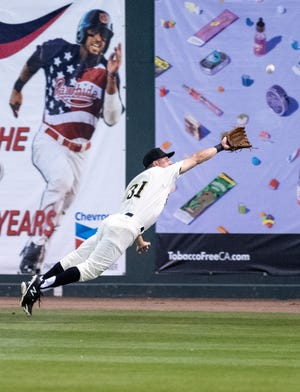 Visalia's Jake McCarthy takes a hit away from San Jose in the Rawhide's home opener on Thursday, April 4, 2019.
