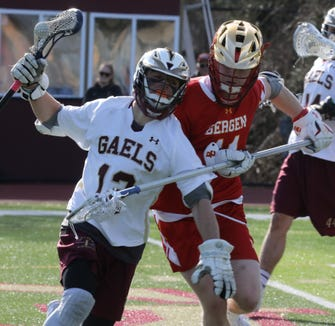 Bergen Catholic's Thomas McGee (11) guards Iona Prep's Ryan Trapasso (12) during boys lacrosse game at Iona Prep School in New Rochelle April 4, 2019. Iona Prep defeats Bergen Catholic 11-10